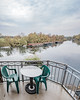 Balcony at river Havel (exkeks) Tags: bokehrama autumn fall river boat chairs table brenizer