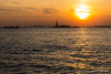 Manhattan sunset (Tómas Freyr) Tags: america newyork usa unitedstatesofamerica city ferðalag travel statueofliberty ladyliberty sunset libertyisland