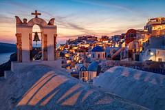 Santorini (adrianchandler.com) Tags: night canon5dsr sunset church mediterranean outdoor oia dusk exterior nightphotography warm santorini adrianchandler architecture cross europe belltower dome greece greek med