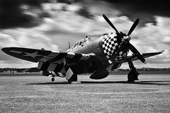P-47 Thunderbolt SNAFU (Huw Hopkins LRPS Photography) Tags: show red summer bw white black classic monochrome up museum plane vintage ir photography flying war long exposure all fighter republic eagle display aircraft aviation air july monotone aeroplane historic collection airshow legends infrared duxford imperial jug normal situation infra cambridgeshire huw warbird hopkins airfield razorback tfc thunderbolt curtiss the snafu iwm black white p47 2011 p47d funked fouled p47g tp47 tp47g p47g10cu p47g10
