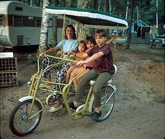 Bicycle Built for Four 1969 (Gwen Deanne) Tags: camping 1969 bike kids vintage surry 1960s camper fringes hippiekids haywardwisconsin flowerpants summerof1969