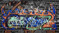 Walled Graffiti (G's Photostream Extravaganza) Tags: bw colour art wall graffiti mono paint