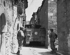 39th Infantry half-track squeezing through a narrow street in Cerami.