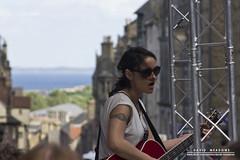 Musician (DMeadows) Tags: sea musician music woman girl sunglasses festival tattoo female buildings scotland edinburgh singing guitar stage horizon crowd perspective royal fringe shades singer vocalist guitarist mile vocal davidmeadows dmeadows davidameadows dameadows