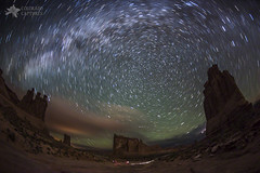 Milky Way Swirls Over Arches Park Avenue (Mike Berenson - Colorado Captures) Tags: longexposure nightphotography sky nature weather night clouds stars landscape utah sandstone colorado arches moab rotation swirls lightning archesnationalpark allrightsreserved startrails parkavenue lightpollution polaris milkyway northstar theorgan sheeprock threegossips courthousetowers airglow nightphotographyworkshop coloradocaptures mikeberenson copyright2013bymikeberenson