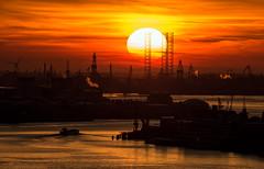 LET THE SUN GO DOWN (CUMBUGO) Tags: city light sunset red sun holland color reflection water port river star smog rotterdam nikon sundown netherland industrie teleskope d800 d800e vision:sunset=099