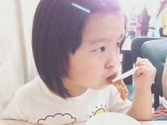 Energy Loading (Zorie Huang) Tags: portrait cute girl asian kid child taiwan eat lovely taiwanese b612 3yearold iphone5 zorie