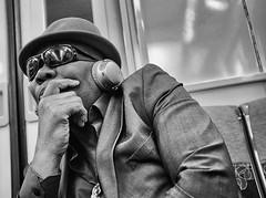 DSCF8372 copie (sergedignazio) Tags: france paris street photography photographie rue fuji x100s rer homme smartphone lunette chapeau
