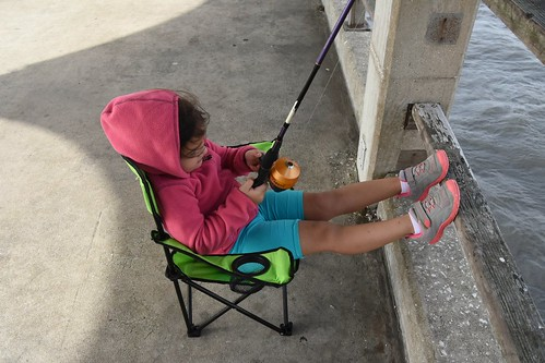 Trying out Nana's fishing pole baited with squid, hoping to catch a small shark.