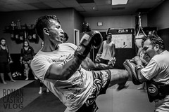 Francisco Garcia 10-25-16-13 (romancastro) Tags: muay thai muaythai blackandwhite kickboxer fighter gym training sandiego valormuaythai bnw x100t fujifilm photojournalism thephotoessay photoessay trainer boxing kick punch grit boxer striker tattoo