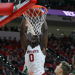 Abdul Malik-Abu dunking the ball in NC State's 2015-16 home opener.