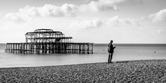 It's Behind You (Sean Batten) Tags: pier beach brighton england unitedkingdom gb nikon d800 60mm clouds person blackandwhite bw westpier
