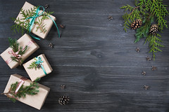 Holiday background with five gift boxes (Olga_Z1982) Tags: christmas greeting gift box rustic background holiday decoration bow ribbon gray wooden cone envelope thuja arborvitae branch green four craft paper
