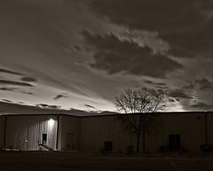 There's a light (TwinCitiesSeen) Tags: sunrise edenprairie minnesota longexposure blackandwhite canont3i tamron2875mm twincitiesseen warehouse
