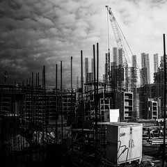 Camp Chaos in Perfect Order (Isaac Hilman (@lifeofisaac)) Tags: chaos rebar lines metal unkempt dirty grungy building construction skyward standing crane bw monochrome city cities contrast square 1x1 fuji x100s street