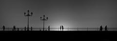 (aesrth) Tags: people life black white shadow sky silhouette street lamp couple kiss hug selfie walking distant railing railings spain seville bridge andalucia andalusia blackwhite sun sunset