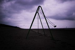 Lost Place (JennylovesAbby) Tags: lost place beach mystery purple dark horror alone supernatural ghost cloudy cloud swing landscape shadow