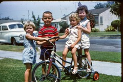 Jammie Terry Jannie and Deena on Tricycle - August 1961 (kimstrezz) Tags: 1961 terryandpatsslides tricycle terry deena jannie jammie