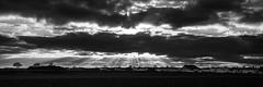 Graben at 3:37 p.m. (++sepp++) Tags: bayern clouds deutschland landscape landschaft landschaftsfotografie lechfeld länder wolken graben bw blackwhite monochrom sw schwarzweis einfarbig bavaria sonnenstrahl rays sunrays häuser houses village dorf