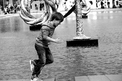 amsterdam (wojofoto) Tags: boy blackandwhite bw amsterdam museumplein jumping zwartwit zw jongen springen wojofoto