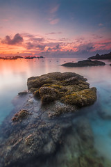 Redang Islang: A calm morning at low tide (Hafidz Abdul Kadir) Tags: travel light red sea vacation sky orange cloud sun sunlight color tourism beach water sunshine weather yellow stone night sunrise canon season relax landscape photography mirror scenery colorful paradise surf day waves peace open view natural outdoor background traditional horizon dream wave sunny nobody clear shore malaysia slowshutter tropical getty 5d rest splash tranquil pantai terengganu scapes gettyimages squeaky twop flickraward 1635f28 5dmark2