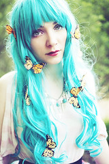 Pluie de Monarque (andreannelupien) Tags: girl forest butterfly insect teal makeup insects greeneyes curly monarch redlips curlyhair monarchs tealhair