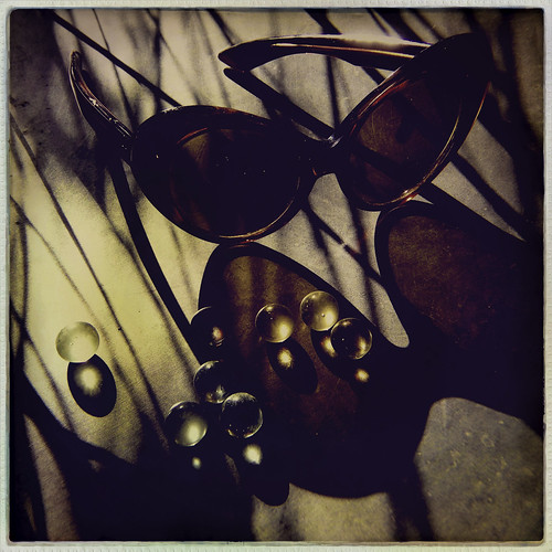 still life with marbles and sunglasses