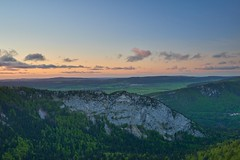 After sunset - Creux du Van (Sinar84 - www.captures.ch) Tags: blue trees sunset red orange sun white lake black green water stone clouds forest way switzerland evening spring day dusk swiss gray may cliffs clear gras rays vaud 2015 creuxduvan
