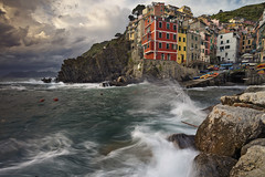 Riomaggiore. (Rudi1976) Tags: riomaggiore cinqueterre traveldestinations italy thunderstorm weather laspezia town mediterraneancountries liguria coastline mediterraneansea cityscape sunset famousplace harbor europe village dusk watersedge architecture rockycoastline highangleview travel tourism liguriansea fishingvillage twilight colorimage locallandmark nationallandmark outdoors horizontal dramaticsky unesco landscape outdoor water waves