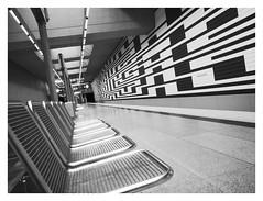 Designed to Wait (memories-in-motion) Tags: architektur bahnhof station ubahn subway underground mnchen black white maze sitze seat dof zentralperspektive public transport mono schwarz weiss lumixgvario714f40 panasonic 14mm