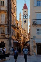 The Clock Tower, Corfu Town, Greece. (Malinki_Malinki) Tags: corfu  korfu corcyra krf corfou  outdoor greece clocktower churchtower tower clock shops restaurant cafe walk stroll