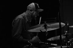 Hit them skins (Steve.T.) Tags: drummer drumming music musician rickkent symbols drums newcrawdaddyclub billericay essex livegig livemusic grimmace facialexpression blackandwhite mono bnw blur drumsticks