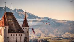 The Patrouille Suisse salutes Thun (VandenBerge Photography) Tags: patrouillesuisse thun canon castle mountains stockhorn almend airplain f5etigerii retro landscape ef100mmf28lmacroisusm 2016 berneseoberland switzerland schweiz sky show