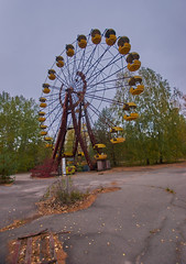 Pripyat Amusement Park (Chernobyl Exclusion Zone) (Landie_Man) Tags: none pripyat chernobyl ionising radiation radioactive fair fairground amuse amusements amusement park may day parade soviet union ussr cccp disused abandoned forgotten left sad never opened ran communism communist fun ferris wheel bumper cars dodgems swing ride swings nature reclaim redstar red star cliche clche