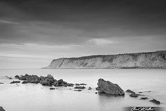 Rocks in a row (BW) (Clear Of Conflict) Tags: bizkaia getxo basque country landscape seascape coast rocks sunset sundown dusk euskadi euskal herria pais vasco spain cliffs mountain bn blanco y negro black white mono monochrome