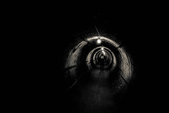 Trapped (kylebagleyphotos) Tags: tunnel narrow claustrophobic claustrophobia tight space missilesilo military base coldwar old antique war bunker fallout blackandwhite bw walkway photography scary dark shadows half life movie