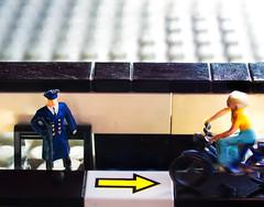 Big Trouble in Tiny Legoland (Silke Klimesch) Tags: macromonday arrow hmm makrofotografie tinypeople figurines lego faller preiser noch traffic police bicycle policeman officer cyclist man woman trouble bigtroublein trafficoffence trafficoffender speed motionblur pfeil verkehrssünder polizei fahrrad fahrradfahrerin geschwindigkeit bewegungsunschärfe focusstacking olympus omd em5 zuiko35mm135