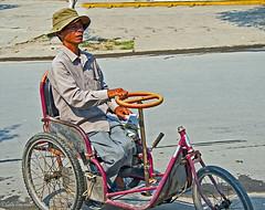 Handicapped man (Jom Manilat) Tags: handicapped man selling lottery tickets hoi an vietnam viet nam