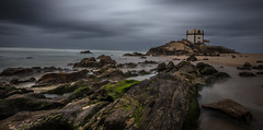 Senhor da Pedra Chapel (Artur Tomaz Photography) Tags: green senhoradapedra sky blue chapel cloud longexposition ocean religous rocks sand sea water wind