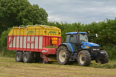 New Holland TM190 Tractor with a Pottinger Jumbo 6000 Silage Pick Up Wagon (Shane Casey CK25) Tags: new holland tm190 tractor pottinger jumbo 6000 silage wagon cnh nh castlelyons blue newholland casenewholland silage16 silage2016 grass grass16 grass2016 winter feed fodder county cork ireland irish farm farmer farming agri agriculture contractor field ground soil earth cows cattle work working horse power horsepower hp pull pulling cut cutting crop lifting machine machinery nikon d7100 traktori tracteur traktor trekker trator cignik