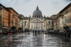Perspectives: San Pietro from Via della Conciliazione (Bebo_cik) Tags: landmark historicalsite sanpietro people street rain italy rome roma church