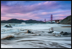 Marshall's Sunset (Aaron M Photo) Tags: ocean sanfrancisco california bridge sunset sky seascape motion beach nature water clouds landscape lights golden movement nikon rocks waves unitedstates pacific suspension marin ducks wave spray marshall pacificocean goldengatebridge goldengate manmade splash suspensionbridge presidio marinheadlands ggb marshallbeach siliconvalleyphotography aaronmeyersphotography