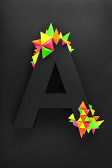 'a' virus (Twan van Keulen) Tags: light black color colour look dark paper studio poster typography design 3d cool triangle neon graphic bright handmade colorfull glue capital creative super cover type letter van helvetica virus twan handwork oneletter matte keulen byhand colourfull cmyk dutchdesign blackonblack gloeilamp couldbeart