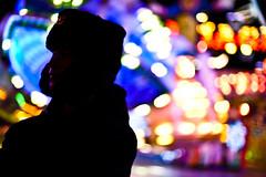 Silhouette (kohlmann.sascha) Tags: lighting light shadow people man berlin silhouette backlight de deutschland licht market bokeh availablelight illumination technik carousel menschen event mann markt veranstaltung technique schatten karussell beleuchtung mensch  jahrmarkt horizontalrotatingtable ilobsterit