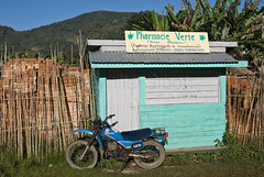 Rural pharmacy 'Pharmacie Verte' (Green Pharmacy) in Ranomafana, Madagascar (Cyrille Gibot) Tags: africa color green shop horizontal retail rural closed nobody motorbike pharmacy boutique tropical concept apothecary drugstore madagascar prevention outlet pharmacist medicines disease chemist publichealth diseases pharmaceutical vaccination ranomafana vaccinations dispensary druggist medicalcare