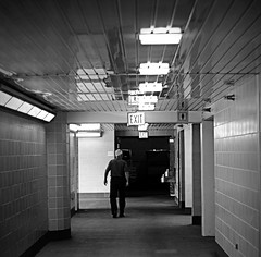 Exit (Cragin Spring) Tags: city urban bw chicago man hall illinois midwest downtown chitown hallway il millenniumpark exit chicagoillinois chicagoil windycity