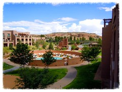 a view from a room (milomingo) Tags: sky sun mountain newmexico southwest pool architecture clouds circle outdoors hotel view pueblo albuquerque sunny courtyard resort adobe round recreation circular recreational bernalillo tamaya hyattregencytamayaresort