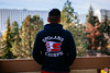 Spokane View (Rob Moses) Tags: spokane washington wa usa unitedstatesofamerica pnw pacificnorthwest chiefs whl spokanechiefs hoodie fashion man dude guy nativeamerican tlingit buildings view bokeh canon eos 6d 2470mm 2470l hotel redlion rl deck balcony trees riverfrontpark sweater travel