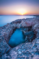 Cyprus, Agia Napa, Vathia Gonia (sebileiste) Tags: cyprus zypern agia napa vathia gonia mediterranean sea mittelmeer sunset sonnenuntergang long exposure felsen stones rock steine brcke bridge stonebridge steinbrcke orange light blue water nikon d90 sigma 1020mm