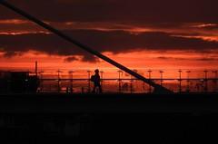 She can't be late (crusader752) Tags: sunset clouds bridge silhouettes woman lady silhouette evening adurferrybridge shorehambysea shoreham riveradur cloudsstormssunsetssunrises